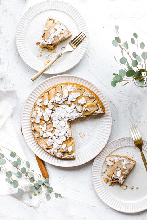 Vegan Italian Pear Almond Cake sliced on plates with top view