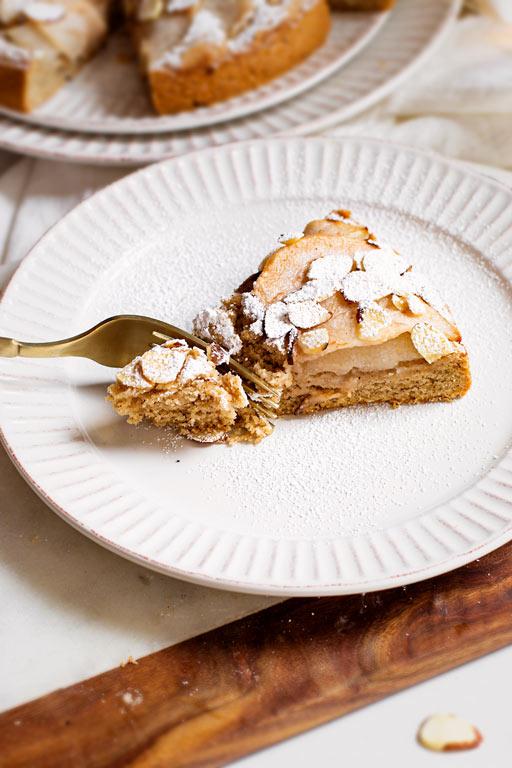 eating the vegan pear almond cake