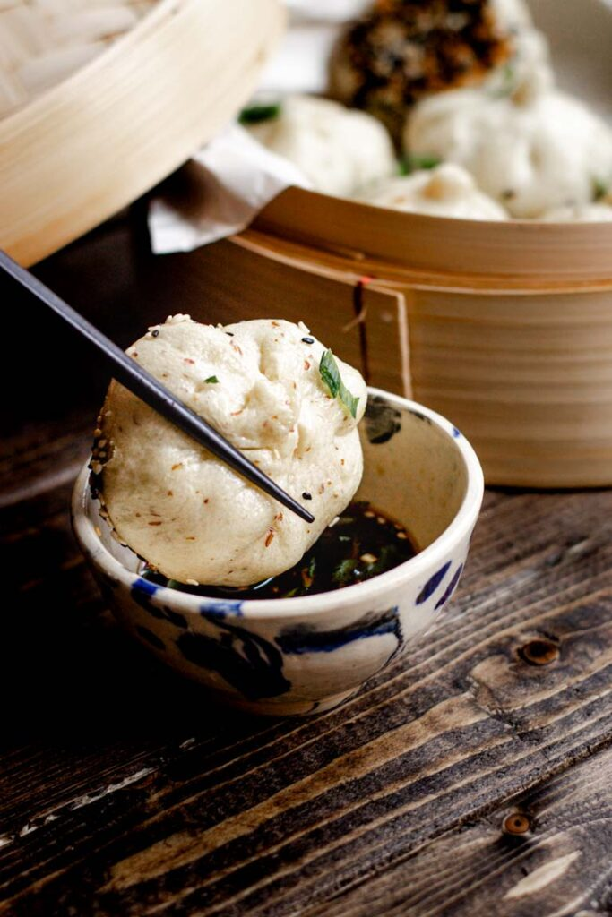 dipping the tofu bun in soy sauce