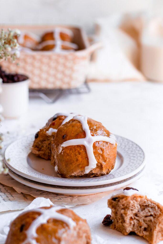vegan hot cross buns on plate