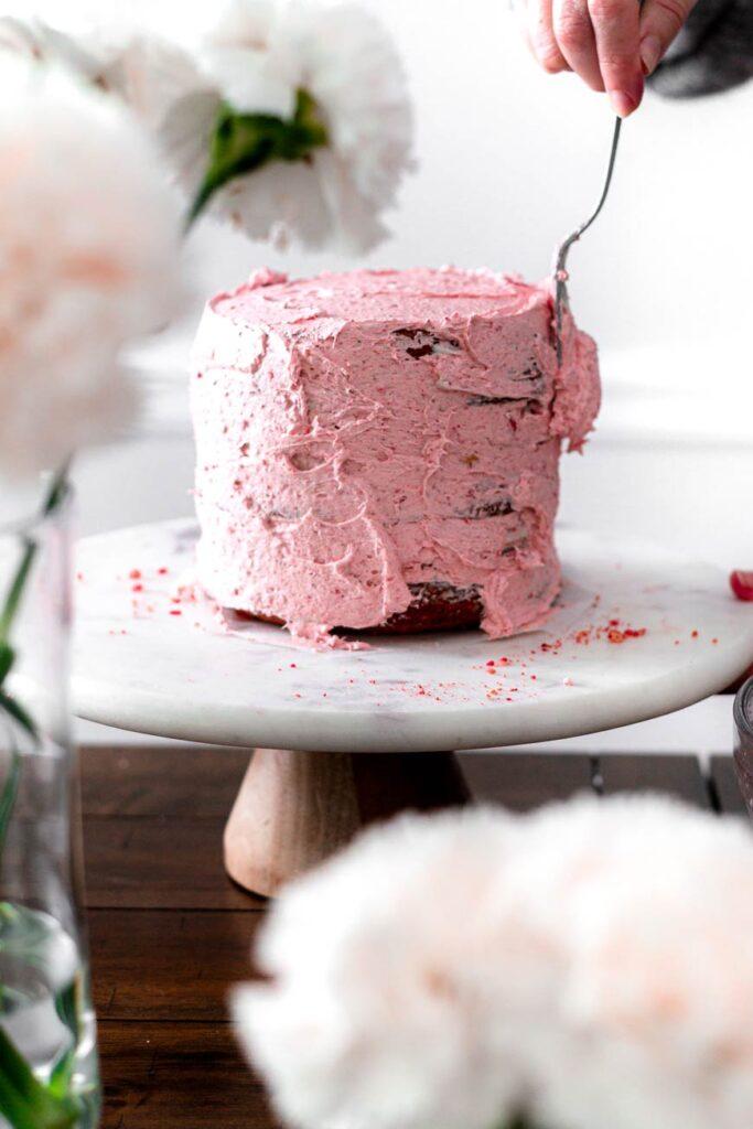 icing a vegan strawberry cake