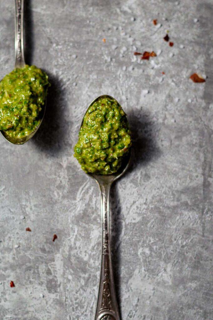 the classic vegan basil pesto on a spoon