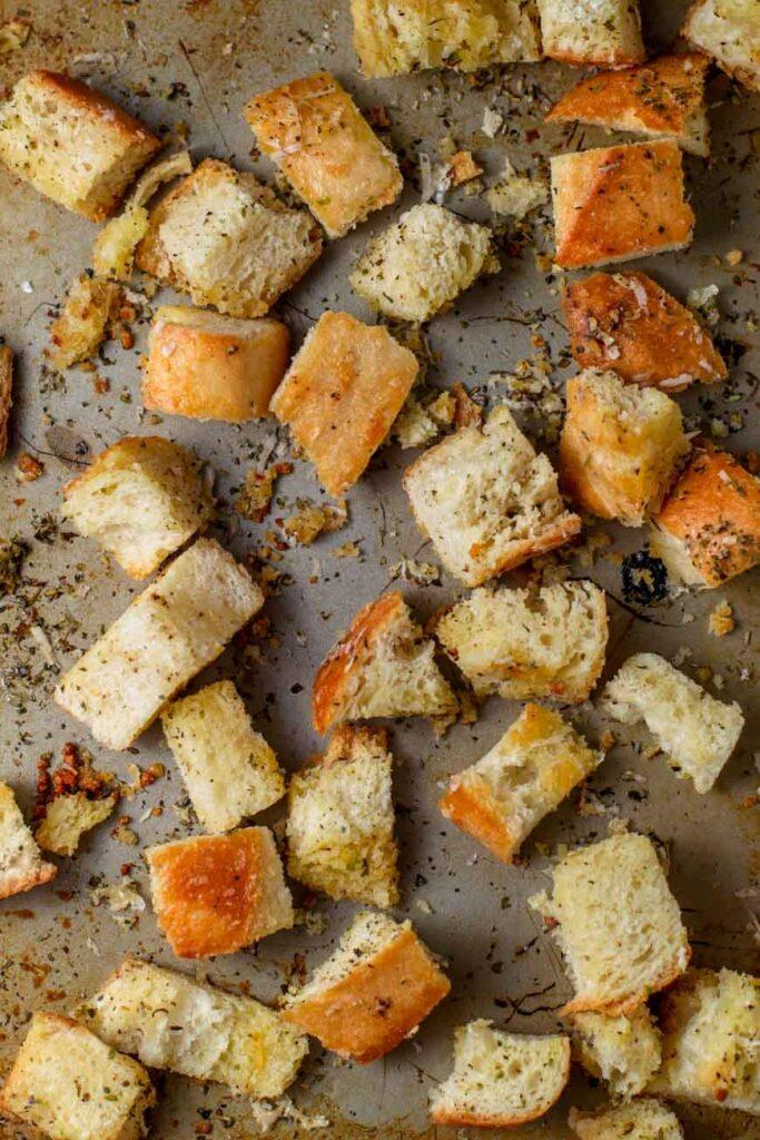 homemade garlic herb croutons on baking sheet
