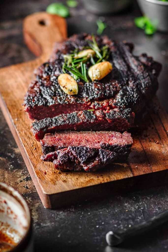 sliced vegan steak on a cutting board